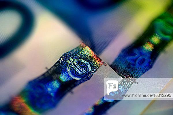 Close up of Euro symbol on bill