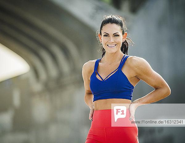 USA  California  Los Angeles  Portrait of woman wearing sports bra