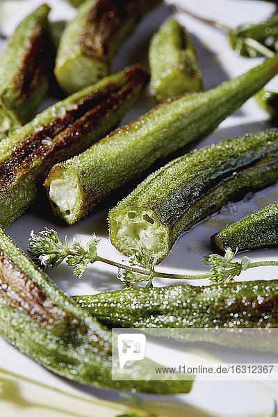 Close up of roasted okra pieces