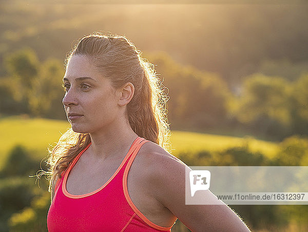 USA  Woman in running outfit standing in field