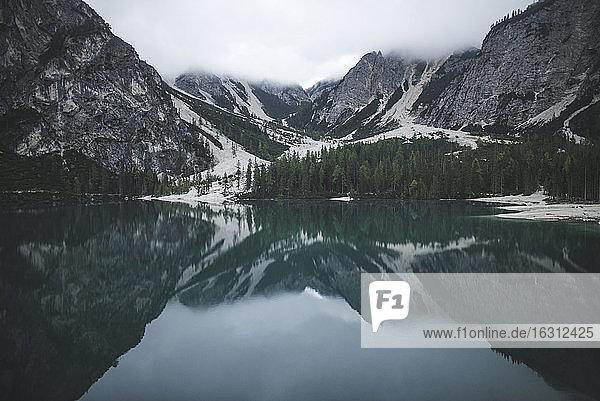 Italy  Pragser Wildsee  Dolomites  South Tyrol  Mountain range reflecting in lake