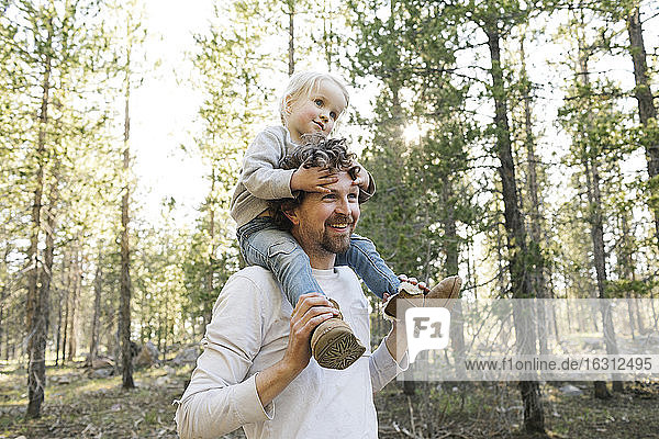 Father carrying little daughter (2-3) on shoulders in Uinta-Wasatch-Cache National Forest