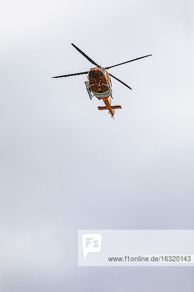 Rescue helicopter flying in sky