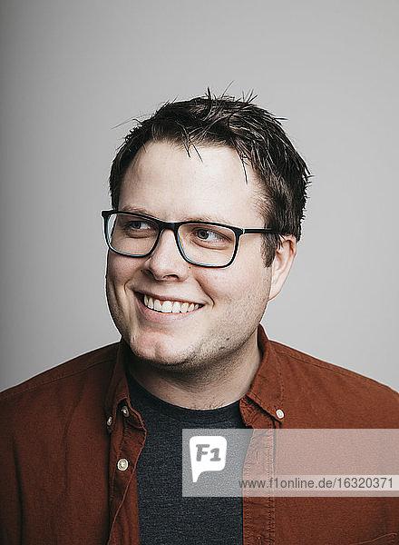 Portrait smiling  confident man in eyeglasses