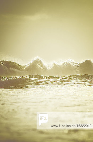 Indonesia  Bali  breaking waves in the evening light