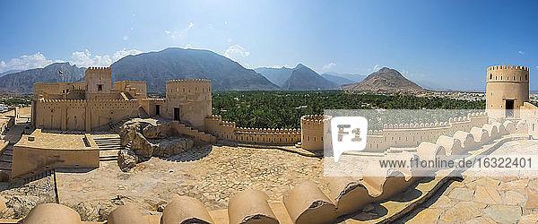 Oman  Al Batinah Region  Al Hajar Mountains  Nakhal  Panoramic view  Fort Nakhal  oasis Nakhal and Jebel Nakhl massif