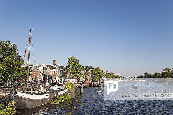 Netherlands  County of Holland  Amsterdam  Magere Brug  river Amstel with boats