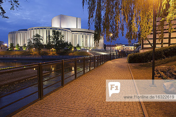 Poland  Bydgoszcz  Opera Nova at night  alley on Mill Island along Brda River