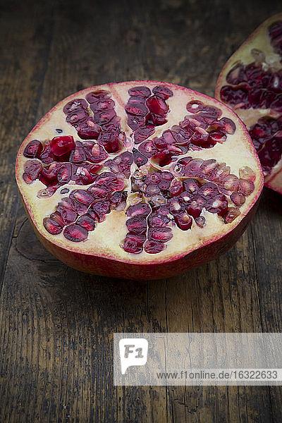 Sliced pomegranate on wood