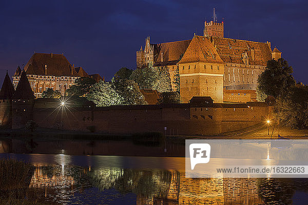 Poland  Malbork Castle at River Nogat at night