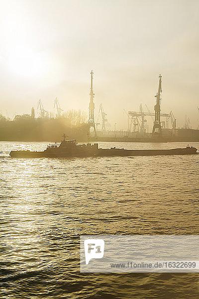 Germany  Hamburg  harbor facility and ship in the evening light