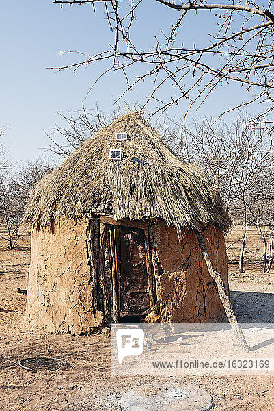Namibia  Damaraland  hut with solar panels on the roof in a Himba village