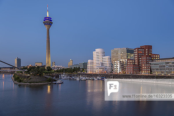 Germany  North Rhine-Westphalia  Dusseldorf  Media Harbor with TV tower and Gehry Buildings in the evening