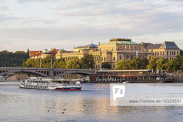 Czech Republic,  Prague,  tourboat on Vltava and Rudolfinum conchert hall and gallery building