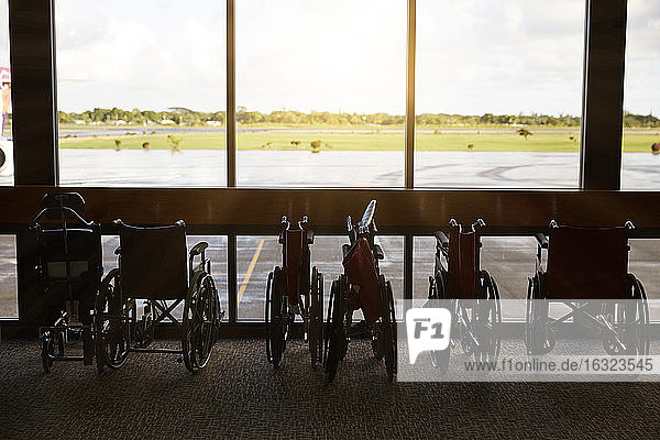 USA  Hawaii  row of parked wheelchairs at the airport