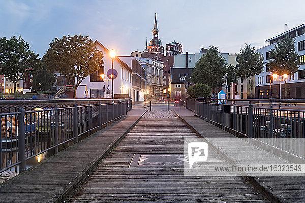 Germany  Mecklenburg-Western Pomerania  Stralsund  Trail bridge in the evening  St. Nicholas' Church in the background