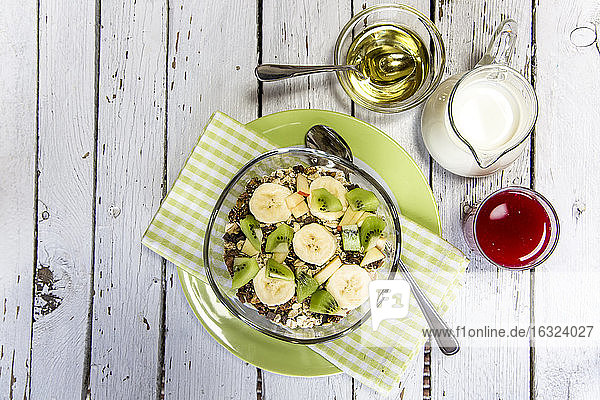 Healthy breakfast with muesli  fruit  milk  agave syrup and juice