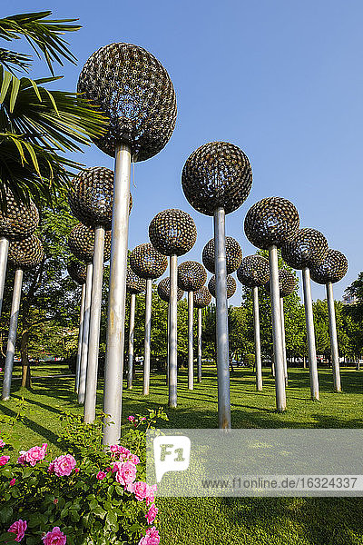 Albania  Shkoder  city park  flowers made of ammunition and arms