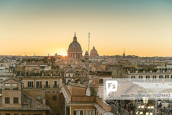 The skyline of Rome with San Carlo al Corso and St. Peter's Basilica before sunset seen from the Spanish Steps  Italy
