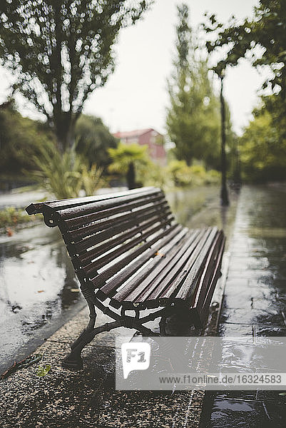 Spain  Galicia  Ferrol  Bench in a promenade  rain