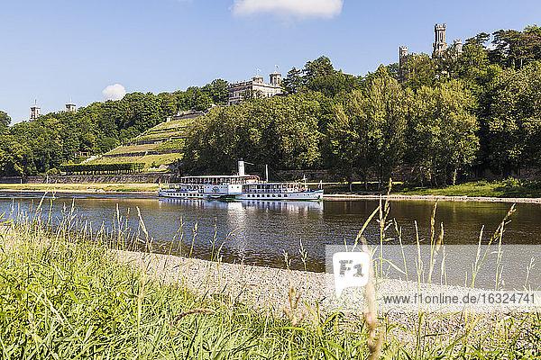 Germany  Dresen  Paddlesteamer on Elbe river passing the three Elbe Castles