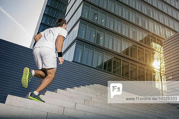 Sportsman jogging upstairs