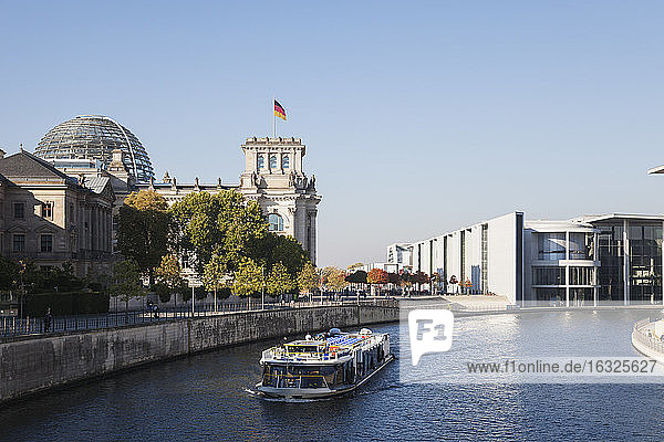 Germany  Berlin  Reichstag building and Paul-Loebe-Haus at Spree River  tourboat