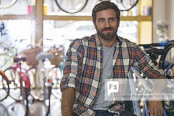 Owner sitting in bicycle shop