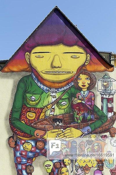 Happy giant in a play suit  surreal figure  mural of the Brazilian streetart artist duo Os Gemeos  Düsseldorf  North Rhine-Westphalia  Germany  Europe