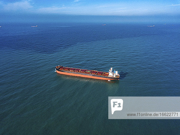 Aerial view of container ship sailing in Sea of Japan
