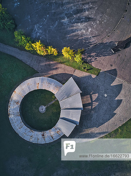 Directly above view of open-air theater with long shadow during sunset