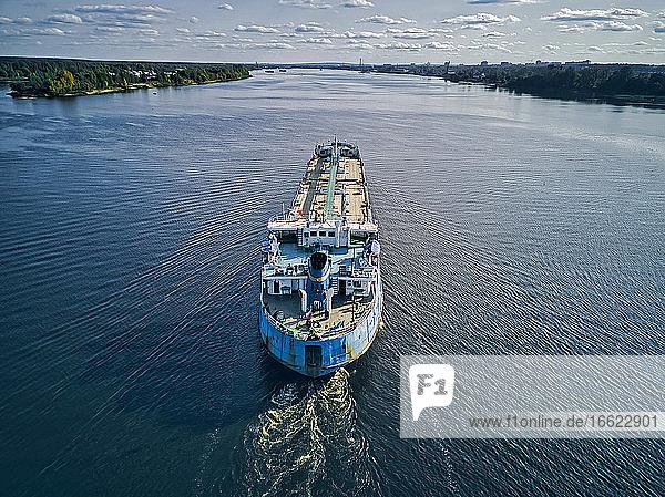 Oil tanker on Volga River against sky