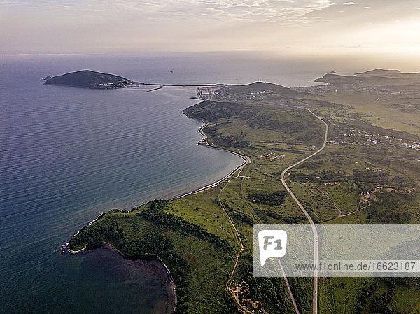 Russia  Primorsky Krai  Zarubino  Aerial view of coastal roads stretching along shore of Sea of Japan at dusk