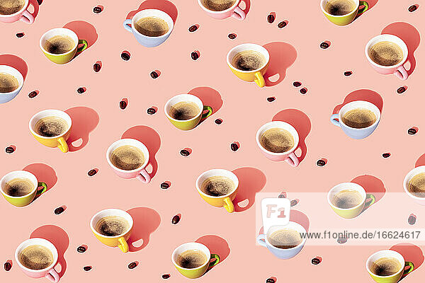 Pattern of roasted coffee beans and coffee cups
