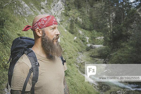 Mature man wearing bandana standing against trees in forest  Otschergraben  Austria