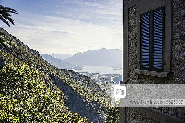 Italy  Province of Sondrio  Corner of building overlooking valleyin Riserva Naturale Pian di Spagna e Lago di Mezzola
