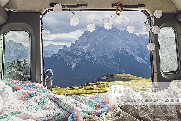 Scenic view of mountain range against sky seen from campervan  Sesto Dolomites  Dolomites  Alto Adige  Italy