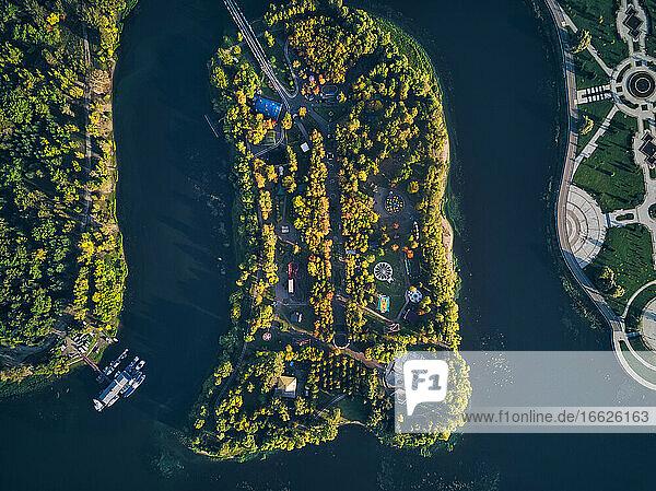 Drone shot of amusement park amidst Kotorosl River