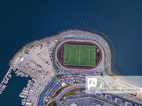 Russia  Primorsky Krai  Vladivostok  Aerial view of harbor and coastal soccer field