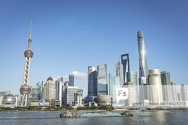 Pudong Area  Special Economic Zone  Municipality of Shanghai  on the eastern bank of Huang Po River  cargo ships  left the Oriental Pearl Tower from the middle the Shanghai Tower  Shanghai  China  Asia