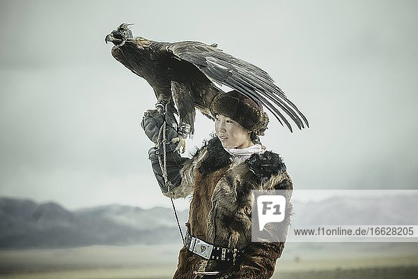 Portrait of a young eagle hunter  Festival of eagle hunters in the province of Olgii  about 20 km from the provincial capital  Olgii  Mongolia  Asia