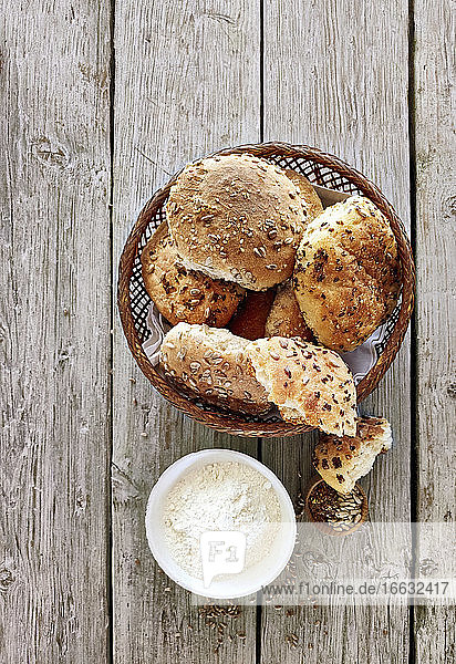 Various seeded rolls in a bread basket