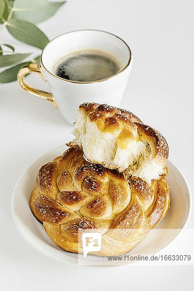 Braided sweet vanilla buns and coffee