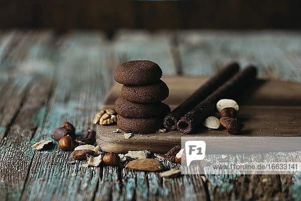 Chocolate cookies with nuts over wooden table