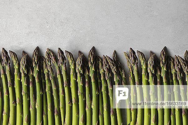 Fresh asparagus on marble table