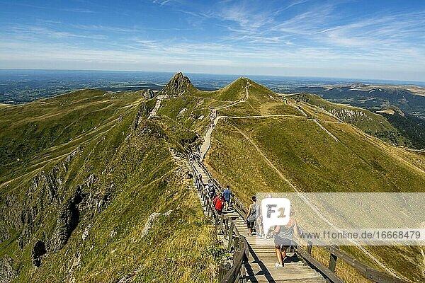 Hikers on way to top of Puy de Sancy  Auvergne Volcanoes Natural Park  Puy de Dome department  Auvergne-Rhone-Alpes  France  Europe