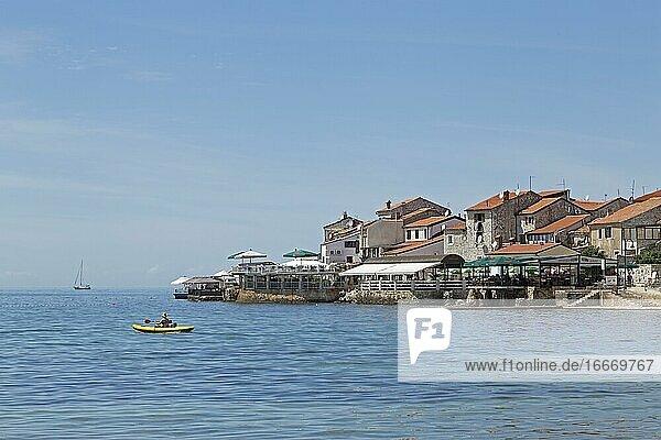 Bathing bay with old town  Umag  Istria  Croatia  Europe
