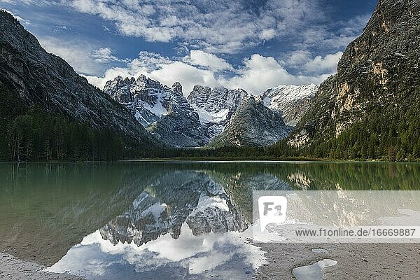 Drought lake  cloud atmosphere  reflection in water  Dolomites  Italy  Europe
