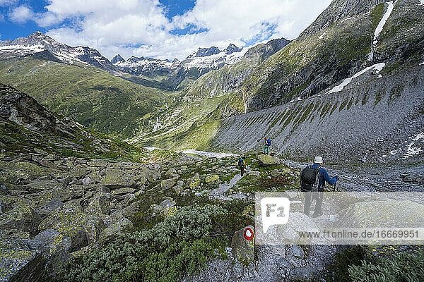 Hiker on marked hiking trail  descent from Schönbichler Horn to Berliner Hütte  moraine landscape  Waxeggkees Glacier  Berliner Höhenweg  Zillertal Alps  Zillertal  Tyrol  Austria  Europe