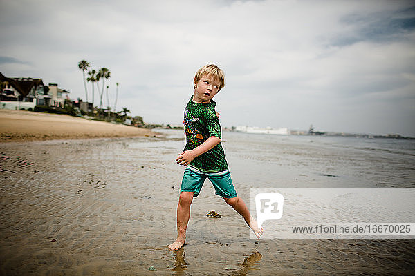 Six Year Old Boy Skipping Rocks in Coronado Bay